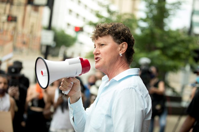 Charmaine McGuffey, the Democratic Candidate for Sheriff, speaks during the Cincinnati Black United Front (CBUF), the Ohio Justice & Policy Center (OJPC) and a broad coalition of civil rights activists and groups press conference, Thursday, June 4, 2020, in downtown Cincinnati outside City Hall.