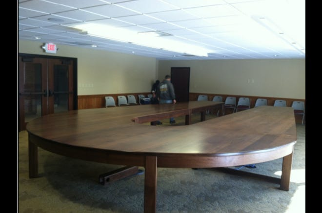 "This ""extravagant and grandiose"" 1.2-ton, handmade walnut conference table was illegally installed at the Ohio Department of Natural Resources headquartered in Columbus."