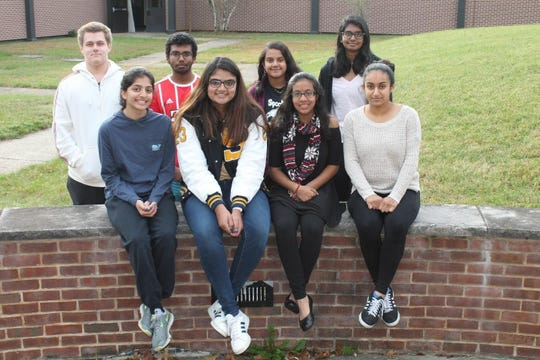 SCVTHS Commended Students in the 2020 National Merit Scholarship Program (back, left to right) William Littwin of Bridgewater, Mayaank Pillai of Hillsborough, Seejal Padhi of Bridgewater, Sanya Ravoori of Hillsborough, (front, left to right) Mira Amin of Bridgewater, Ritu Peddinti of Bridgewater, Krishna Mody of Martinsville and Nidhi Banker of Branchburg pose for a photo in the school's courtyard.