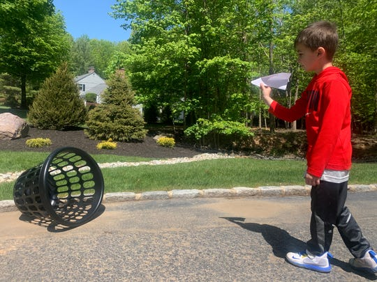 Nathan Lewis chose Paper Plane Throwing for Distance as an activity for Field Day.