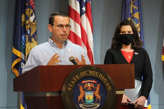Sean Egan, Michigan's coronavirus workplace safety director, speaks at a Friday news conference with Gov. Gretchen Whitmer.