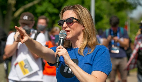 Secretary of State Jocelyn Benson speaks as protesters gather before they march on the MacArthur Bridge across the Detroit River to Belle Isle during a rally in Detroit, Friday, June 5, 2020, protesting police brutality and the death of George Floyd.
