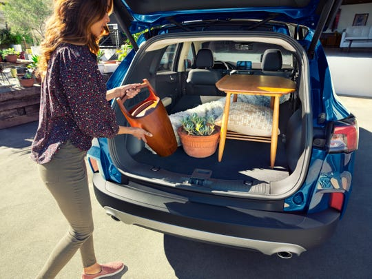 The 2020 Ford Escape plug-in hybrid's lithium-ion battery is beneath the rear seats so it does not reduce the SUV's cargo space.