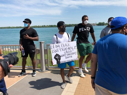 Detroit Lions wide receiver Jamal Agnew marched on Belle Isle on June 5, 2020, holding a sign honoring Breonna Taylor, who would have turned 27. Taylor was shot by police in Louisville on March 13.