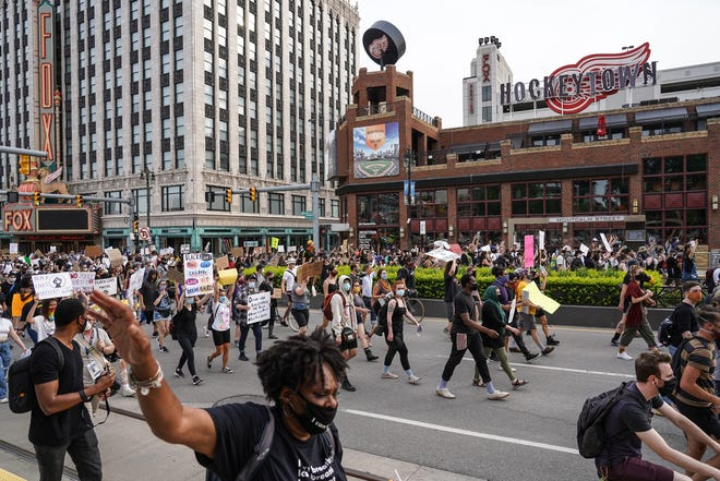 Protesters march along Woodward Ave. through Detroit on the seventh day of protests against police brutality on Thursday, June 4, 2020.