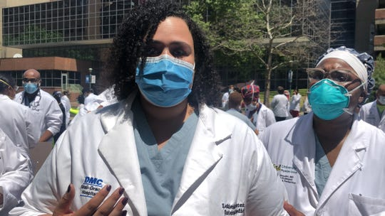 Dr. Lekiesha Porter, an internal medicine resident at Wayne State University Medical School, talks about how systemic racism has affected her life at a White Coats for Black Lives event at the Detroit Medical Center campus Friday, June 5, 2020. Dr. Ijeoma Nnodim-Opara looks on.