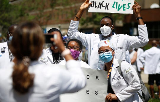 """Several hundred Detroit Medical Center doctors, residents, and Wayne State medical students gather together for the """"White Coats for Black Lives"""" rally in Brush Park on DMC campus on Friday, June 5, 2020."""