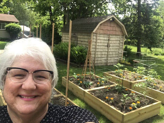 In March, White Lake resident Marion Christiansen was making her family's Italian tomato sauce like nobody's business. Now she says she's gardening all the time.