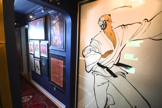 Dark walls set off Lygon's extensive and impressive art collection.
