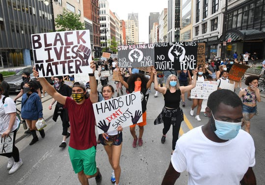 Protestors on the 7th night of demonstrations march down Woodward Avenue in Detroit, Michigan on June 4, 2020.
