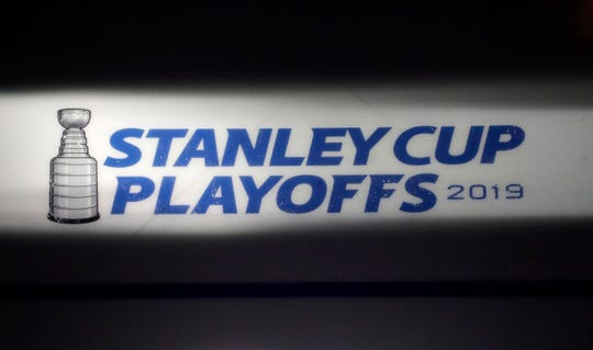 In this April 26, 2019 photo, the Stanley Cup playoffs logo is seen on the ice during a light and sound check prior to Game 1 of an NHL hockey second-round playoff series between the New York Islanders and the Carolina Hurricanes, in New York.