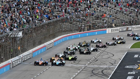 Drivers jockey for position at the start of the IndyCar race at Texas Motor Speedway in Fort Worth in 2019.
