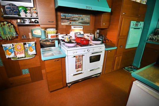 The vintage Kenmore range and Ventahood range hood are  highlights of the retro-style kitchen, which Lygon returned to its original design after a misguided later renovation.