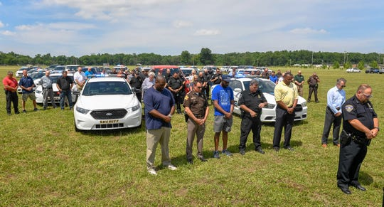 The Evansville Police Department and Vanderburgh County Sheriff's Office held a ceremony in honor of George Floyd Friday afternoon. After a few remarks, the officers held an 8-minute, 46-seconds moment of silence with their lights on at the old Roberts Stadium site, June 5, 2020.
