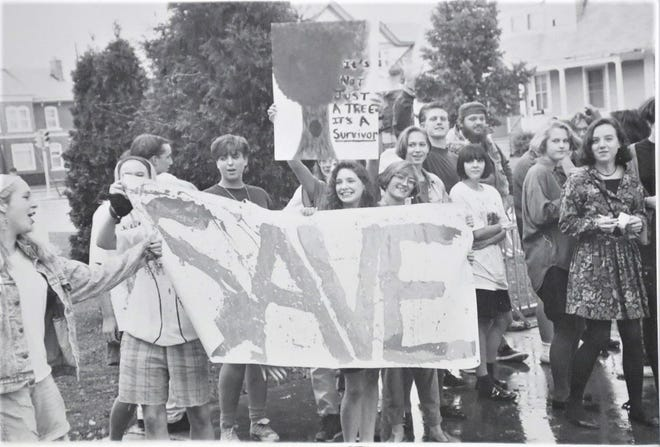 Students from Fond du Lac High School protest the building of the new Aquatic Center on Ninth Street, to save the trees, circa 1991. The image is part of a virtual gallery display celebrating The Reporter's sesquicentennial. The gallery can be viewed on the Langdon Divers Community Gallery Facebook page.