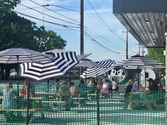 Customers enjoy an evening of beautiful June weather on Thursday on Zambaldi Beer's patio along Webster Avenue in Allouez.