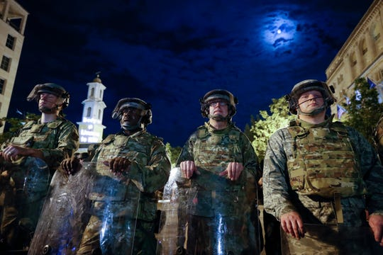 Utah National Guard soldiers stand on a police line as demonstrators gather to protest the death of George Floyd, Thursday, June 4, 2020, near the White House in Washington. Floyd died after being restrained by Minneapolis police officers.