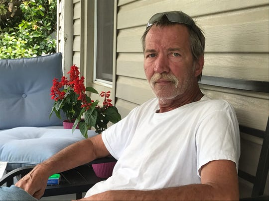 Harold Tennihill sits on his front porch in Pelzer.