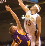 Hays-Lodgepole's A.J. Longsoldier tips in a shot over Big Sandy's Kyle Danreuther Saturday night in the 2007 State C boys' championship game in Great Falls.