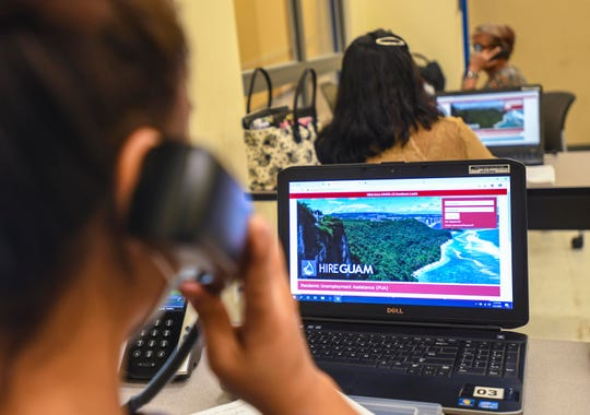 Staff members provide help to individuals interested in filing a Pandemic Unemployment Assistance claim at the PUA call center set up at the Guam Community College in Mangilao on Friday, June 5, 2020.