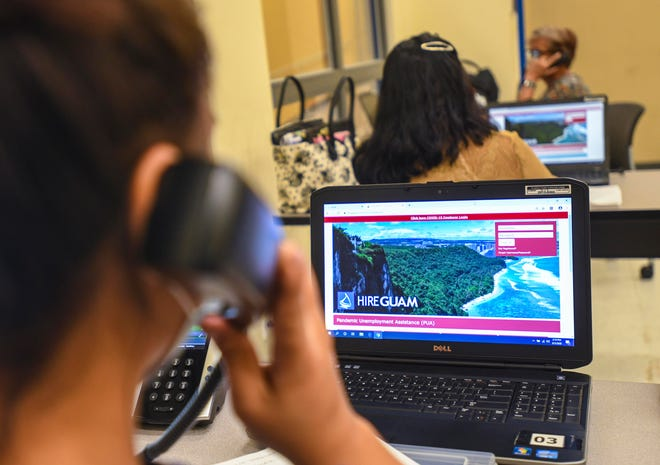 Staff members provide help to individuals interested in filing a Pandemic Unemployment Assistance claim as calls are entertained at the PUA call center set up at the Guam Community College in Mangilao on Friday, June 5, 2020.