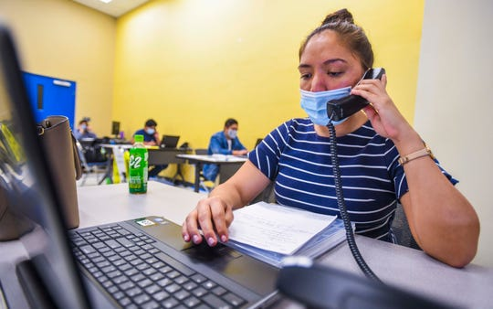Nicole Benavente and other staff members provide help to individuals interested in filing a Pandemic Unemployment Assistance claim as calls are entertained at the PUA call center at the Guam Community College in Mangilao on Friday, June 5, 2020.