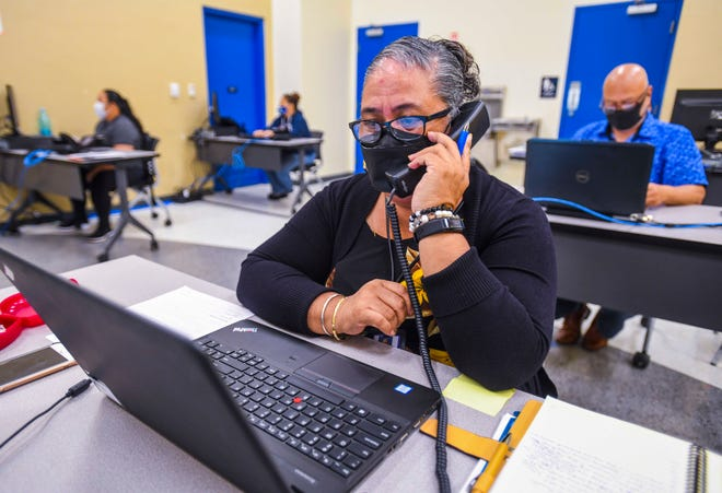 Dorothy Blas and other staff members provide help to individuals interested in filing a Pandemic Unemployment Assistance claim as calls are entertained at the PUA call center at the Guam Community College in Mangilao on Friday, June 5, 2020.