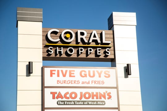 "A sign at the ""Coral Shoppes"" for Five Guys Burger and Fries as well as Taco John's are seen, Tuesday, June 2, 2020, in Coralville, Iowa. The Five Guys location opened in March."