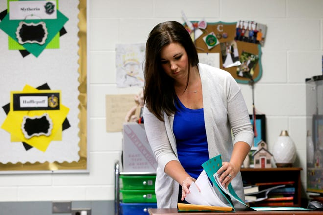 Paige Clinkenbeard, a sixth grade english teacher at East Tipp Middle School, sorts through papers as she packs up her classroom for the summer, Wednesday, May 20, 2020 in Lafayette.