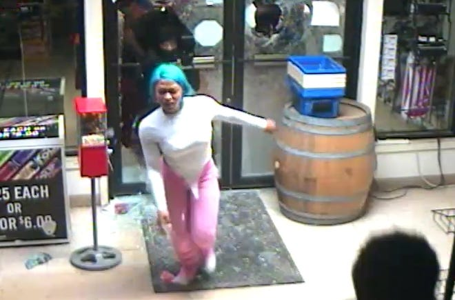 Surveillance video from Tower Liquor store shows a woman police believe to be Franceka Latrice Williams burglarizing the store early Monday during a rash of burglaries and lootings.
