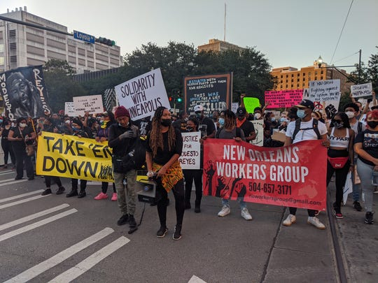 Protesters gather in New Orleans to speak out against police brutality Thursday, June 4, 2020.