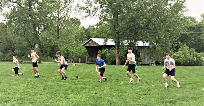 Members of the Lancaster football went through workouts Friday morning, which marks the first time they have been able to workout on school grounds since mid-March because of the coronavirus pandemic.