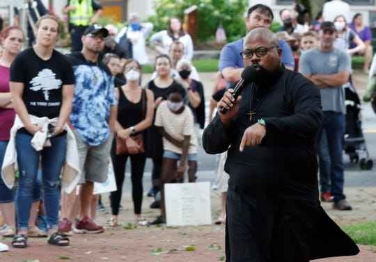 Rev. Casanova Green delivers his sermon to more than 200 people gathered in Zane Square Thursday, June 4, during a peace rally. The event was dedicated to citizen unity and speaking out against police brutality towards people of color after George Floyd's death in police custody in Minneapolis May 25.