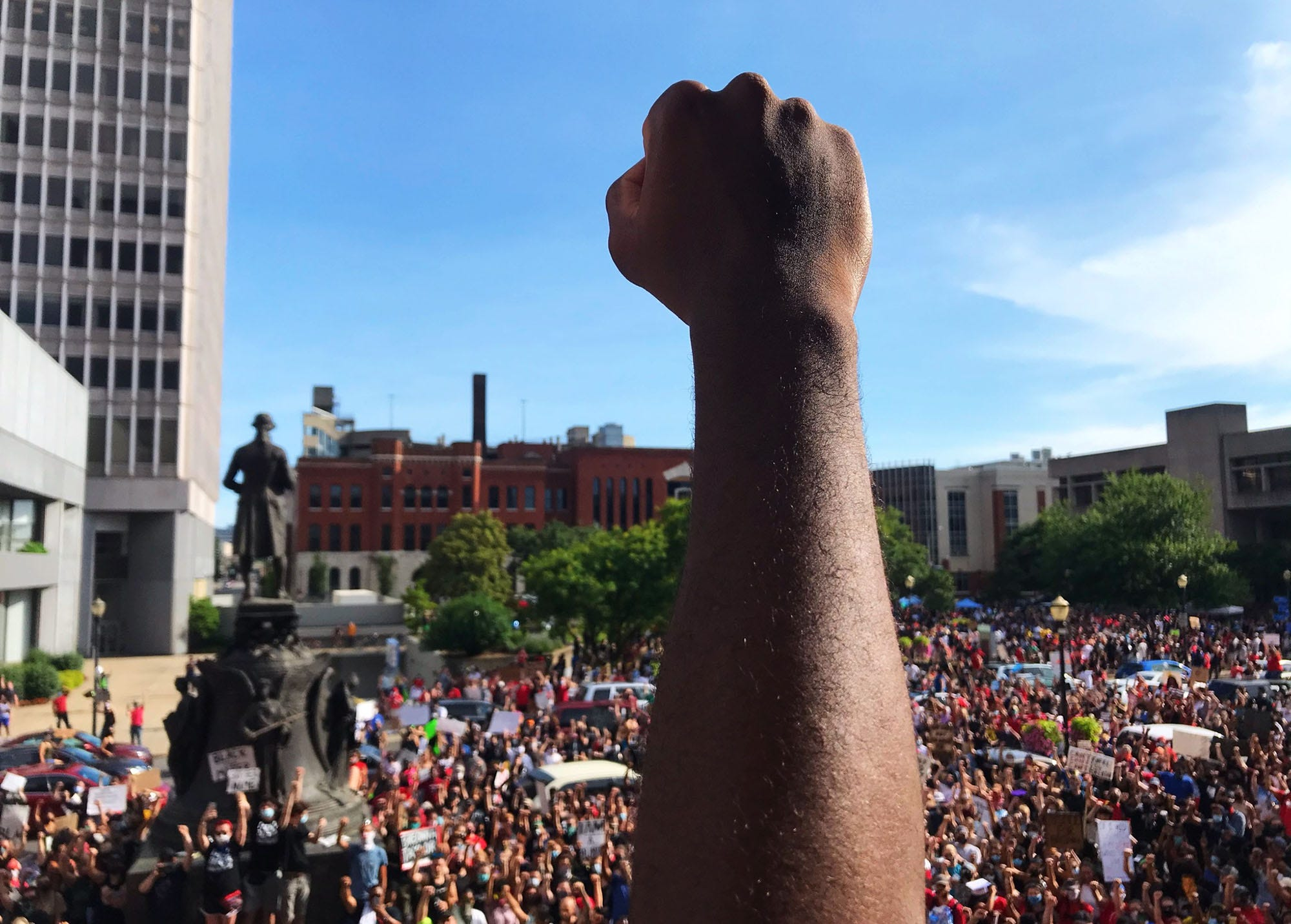 An attendee of the rally in downtown Louisville in Jefferson Square did a fist pump to the crowd below. June 5, 2020.