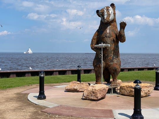 Badger sculpture in downtown Manitowoc created by sculptor Carl Vanderheyden and creator Nick Mueller. The sculpture is near the SS Badger dock on the lakefront.