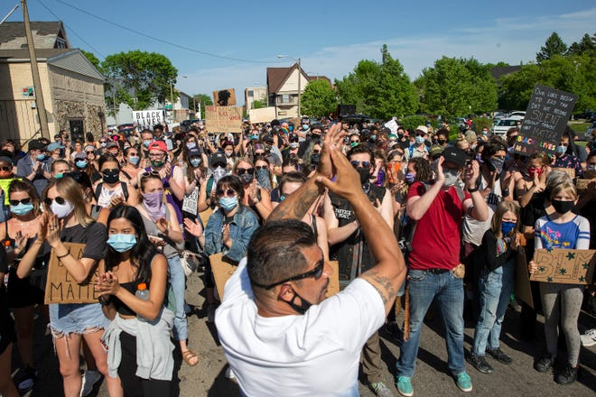 Protesters gather and clap before marching to Wauwatosa on Thursday, June 4, 2020, at North 27th and West Center streets. The protests were in response to the police killing of George Floyd in Minneapolis.
