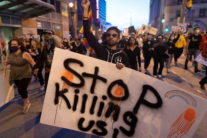 A couple of thousand people marched and protested peacefully on June 1, 2020, in downtown Milwaukee. They were joined by cars blocking traffic. Police monitored the group, but it appeared there were no arrests.