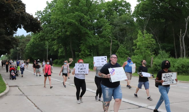 About 50 people march east on Lincoln Avenue in West Allis during a protest on Friday, June 5.