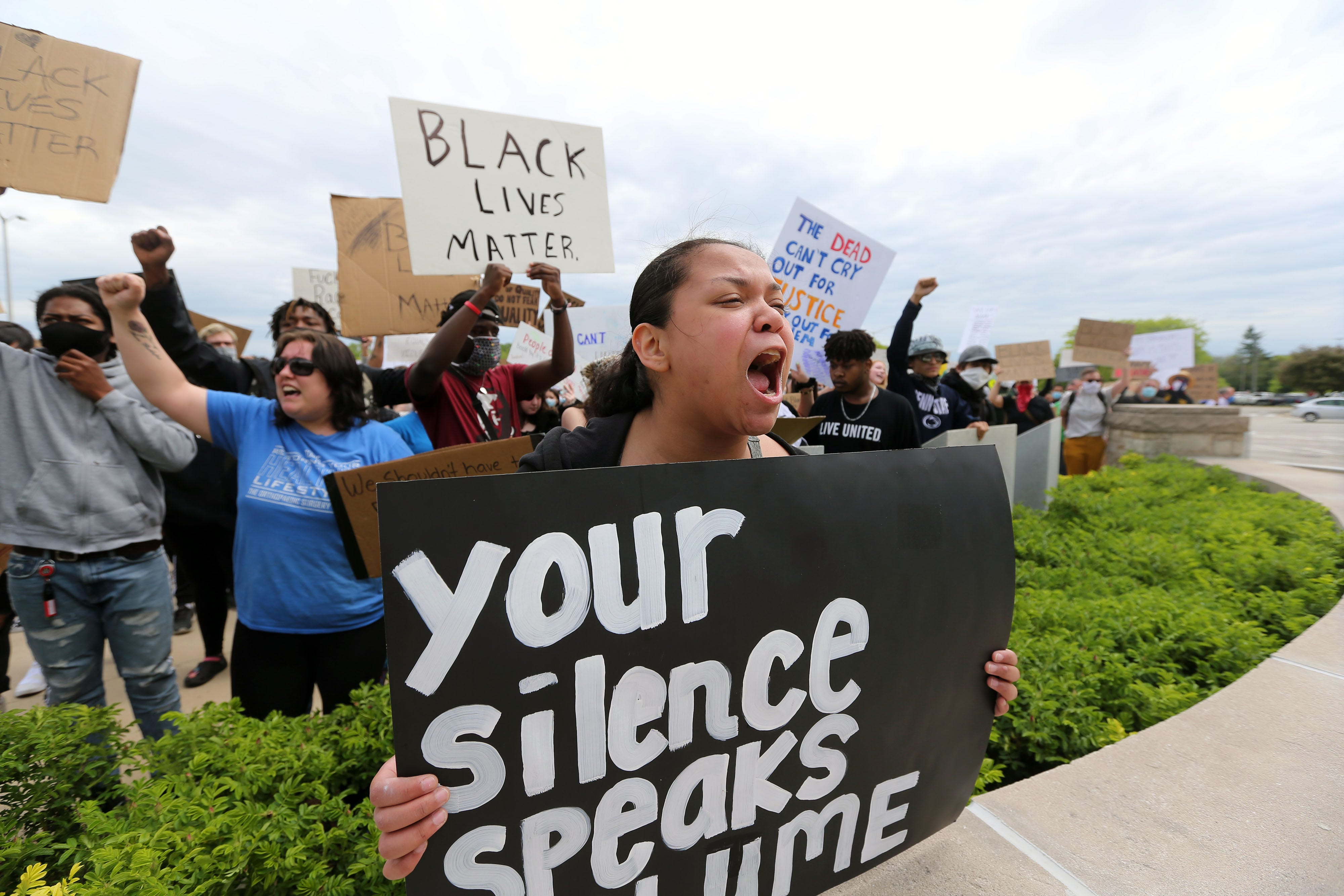 Maliya Lopez Delgade, 21, chants with other protesters in front of the Waukesha County Courthouse to protest the misconduct by police officers on Monday, June 1, 2020. A crowd of over 300 marched through sections of Waukesha to voice their frustration.