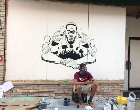 In his mural at the top of State Street, Rodney Lambright II found healing after weeks of struggling to create art.