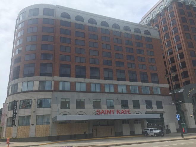 Saint Kate--The Arts Hotel had its windows boarded up Thursday, even as other Milwaukee hotels, including the Pfister Hotel and Potawatomi Hotel, announced reopening plans.