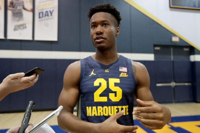 Marquette guard Koby McEwen protested for equality in Milwaukee.