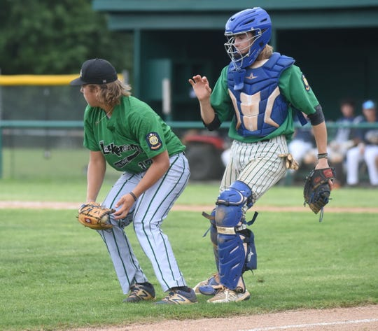 Mountain Home Lockeroom players Jim Strider (left) and Garrett Steelman converge on a bunt during a game last season. Both players return this season for the Lockeroom, which opens its season Saturday at Russellville.
