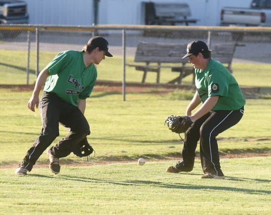 Mountain Home Lockeroom players Tyler Guffey (left) and Tyler Smith converge on a bunt during a game last season. Both players return this season for the Lockeroom, which opens its season Saturday at Russellville.