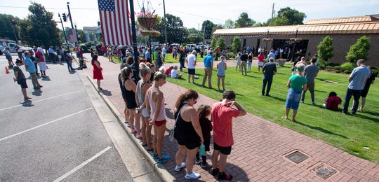 About 200 people gather by City Hall in Prattville, Ala., on June 5, 2020, as pastors from nine local churches and others offered prayed for peace and justice.