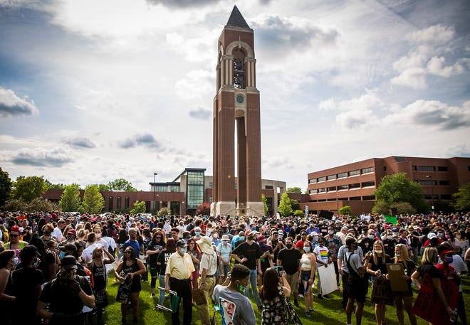 Thousands gathered at Ball State's Bell Tower before marching to City Hall in Muncie for a protest against police brutality against black citizens Thursday, June 4, 2020. Protests have occurred in every state in the nation following the killing of George Floyd on May 25.