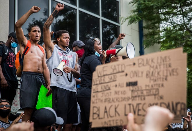 Ball State basketball player Ishmael El-Amin (center) was among the thousands who gathered at Ball State's Bell Tower before marching to City Hall in Muncie during a peaceful protest against police brutality against black citizens on June 4, 2020. Protests have occurred in every state in the nation following the killing of George Floyd on May 25, 2020.