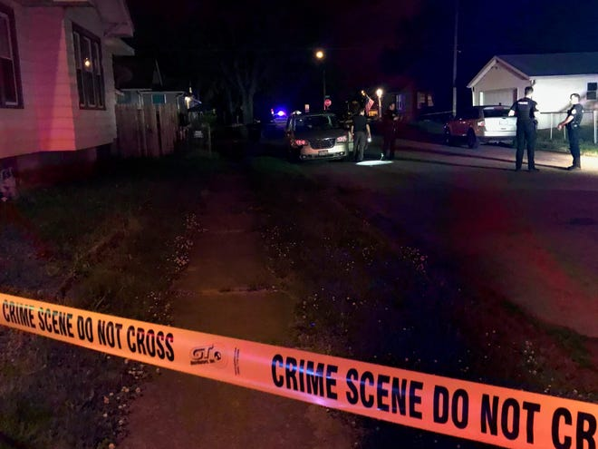 Muncie police early Friday established crime scenes at two addresses along South High Street after a 22-year-old local man was shot.