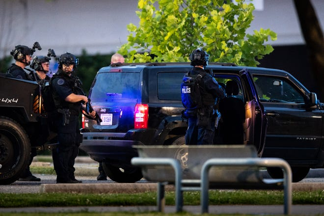 Metro Nashville SWAT officers respond to a report of several armed individuals in a parking lot outside of Nissan Stadium in Nashville, Tenn., Thursday, June 4, 2020.