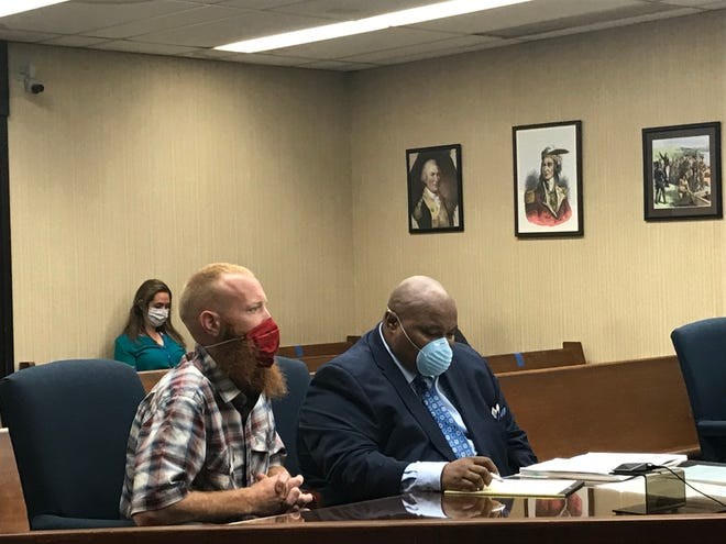 Lawrence Phipps (left) appears with his attorney, Gregory Carter, in Licking County Municipal Court for a sentencing hearing on Friday, June 5, 2020.